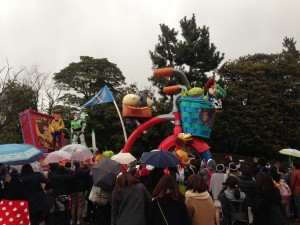 Lets all watch a parade of people dressed as Disney characters in the rain for 15 minutes.